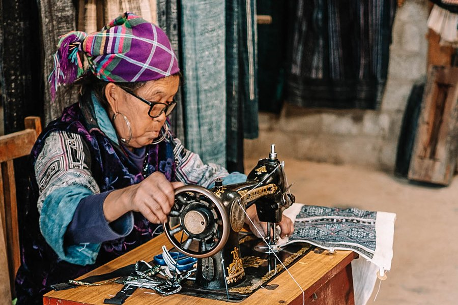 Woman sewing local crafts in Cat Cat Village