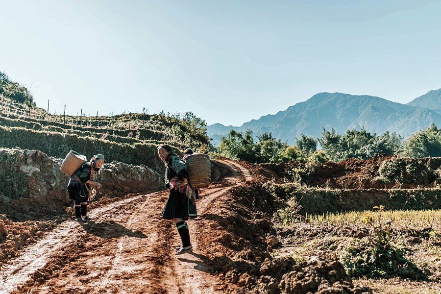 Women carrying back-baskets in Sapa, Vietnam
