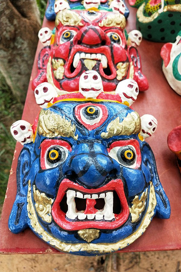 Brightly coloured mask carved in wood - one of 13 traditioanl arts and cratfs in Bhutan