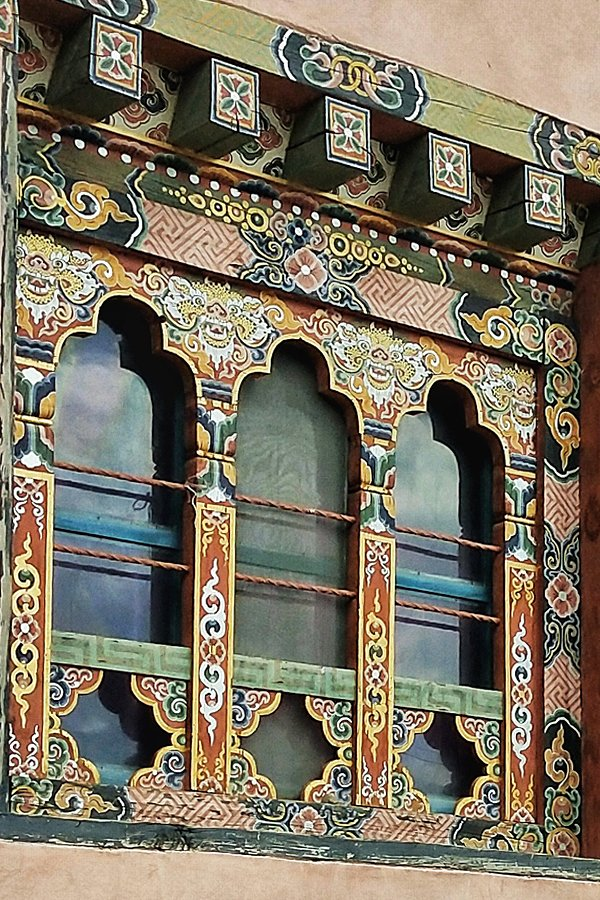 Intricately painted wooden window frame in Bhutan